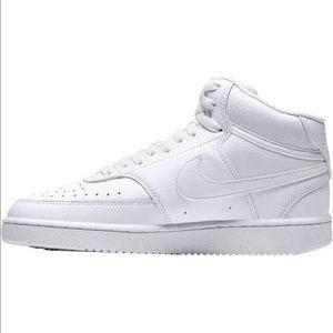 Nike Air Force mid high top sneaker.